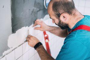 Beaverton Tile worker installing tiles on the wall