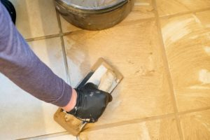 Beaverton tiler applying grout