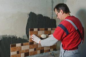 Beaverton worker laying ceramic tiles